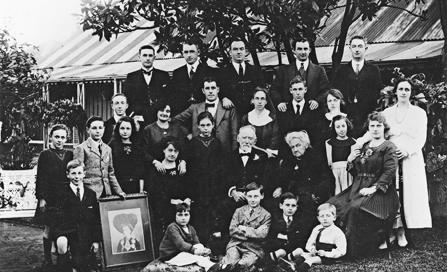 , The extended White family gather in the front garden of Don Bank Cottage for 50th wedding anniversary of James and Johanna (seated in centre) in 1919. Thomas and Catherine, who were living there, are on the far right back and middle row. Stanton Library