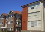 , These neighbouring buildings in Hayes Street, Neutral Bay, are similar in scale and function but show the dramatic change in design over 50 years of flat development. 'Kcot Sedar', on the left, was built in 1913 using the materials typical of the English Revival/Federation era. Though they represented a very modern way of living, these flats would have blended in with the existing housing stock. The block on the right was designed in 1958 and completed by EV Campbell Pty Ltd in 1960. The building demonstrates Modernism's rejection of decoration and typifies the post-war transformation of the suburb. Photograph by Ian Hoskins, 2013