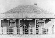 , 'Grace Cottage', shown here in the 1880s, exemplifies the vernacular timber Georgian house. It was transported across the Harbour and reassembled at 137 Mount Street by Thomas Thrussell in the 1870s or 1880s. The right hand side of the verandah was later enclosed to create a display window for fancy goods. The cottage remained in the family until the late 1920s when it was resumed and demolished during Sydney Harbour Bridge work. Stanton Library