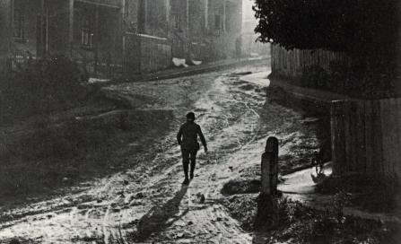 , Photographer Harold Cazneaux lived in Riley Street, North Sydney, in 1908 when this photograph 'Misty Morning, North Sydney' taken. It may indeed depict the photographer's street. Unsealed thoroughfares, such as this, must have made the upkeep of clean interiors extremely difficult. Council began sealing pavements with tar in the 1890s. Roads followed but some remained unsealed well into the 1950s. Courtesy of Sally Garrett. Stanton Library