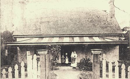, This 1872 photograph shows the newly built 'Roseleigh' with its original front veranda of corrugated iron roof typically painted in broad stripes and filigree iron valance and grilles supporting the roof. The Georgian symmetry of the house is reflected in the planting of the garden. Stanton Library